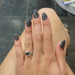 A Woman Show S Off Her Finished Nail Art At Ita Color Yellow Salon On February