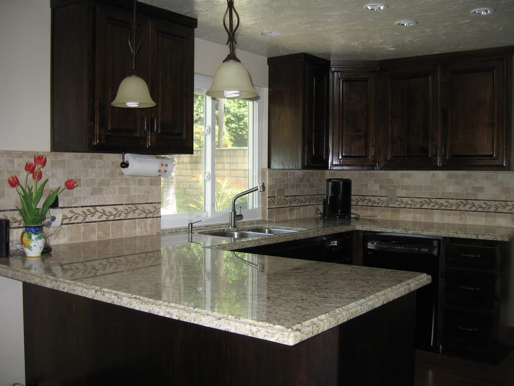 Dark brown cabinets and Giallo Santo granite counter tops ... on Dark Granite Countertops With Dark Cabinets  id=64394