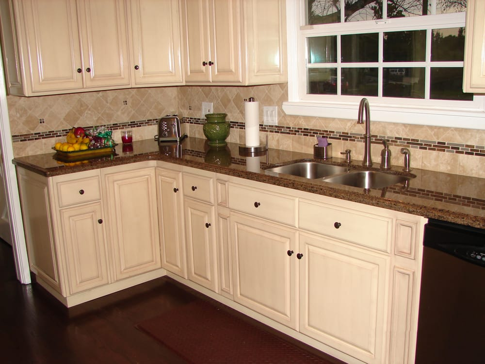 Antique White raised panel cabinets and Tropical Brown ... on Backsplash For Black Granite Countertops And Brown Cabinets  id=94710