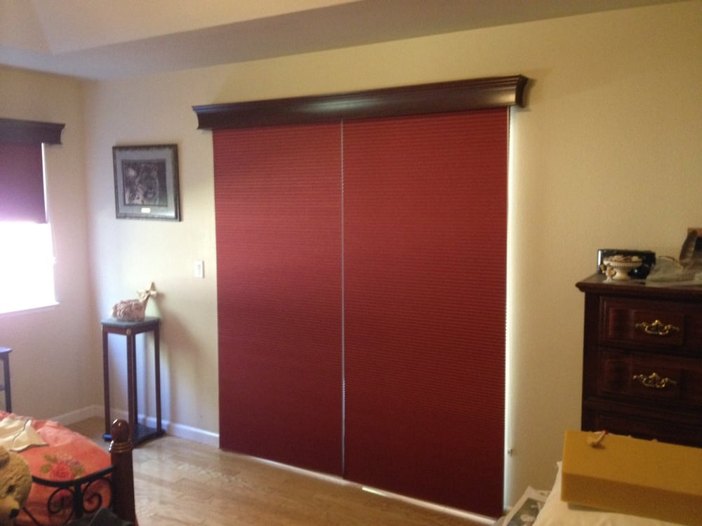Graber Cell Shades Over A Sliding Glass Door With A