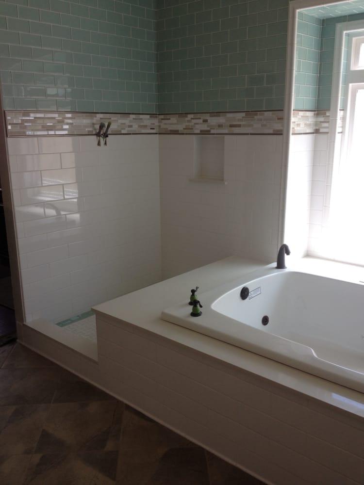 4x9 Ceramic On Bottom Half 3x6 Glass Tile With A Porcelain Border White Quarts On Tub Deck 2x6