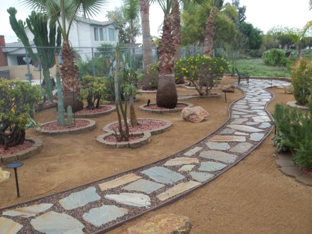 Flagstone walkway to backyard seating area - Yelp on Backyard Walkway Ideas id=29087