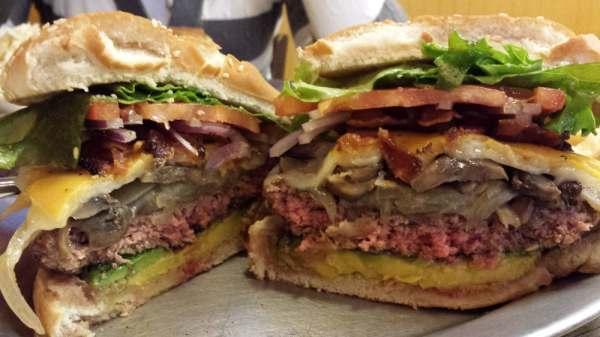 The Challenger...1/2 lb patty, avocado, bacon, cheddar ...