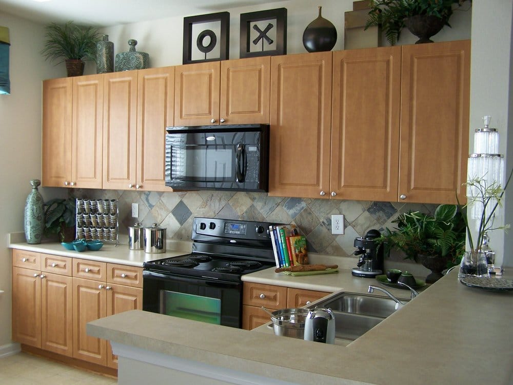 All our homes include microwaves, black appliances, 42 ... on Backsplash For Maple Cabinets  id=76466
