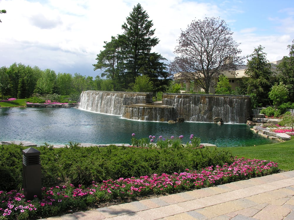 Large cascading waterfall with patio overlooking man-made ... on Front Yard Pond  id=95027