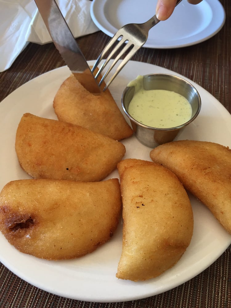 Arepas Cafe - Astoria, NY, United States. Empanadas - shark, chicken, beef and cheese, and another chicken.