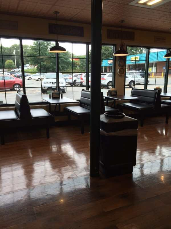 Seating area at the end of the checkout area. These ...