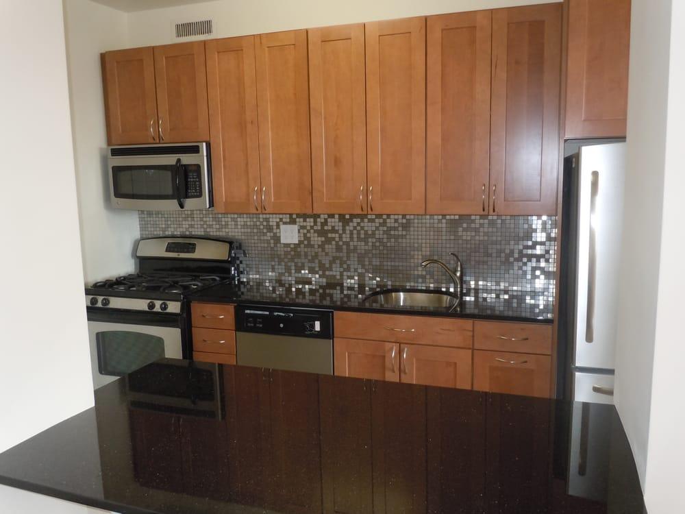 kraftmaid walnut cabinets. Stainless backsplash. Black ... on Backsplash With Black Granite Countertops  id=89769