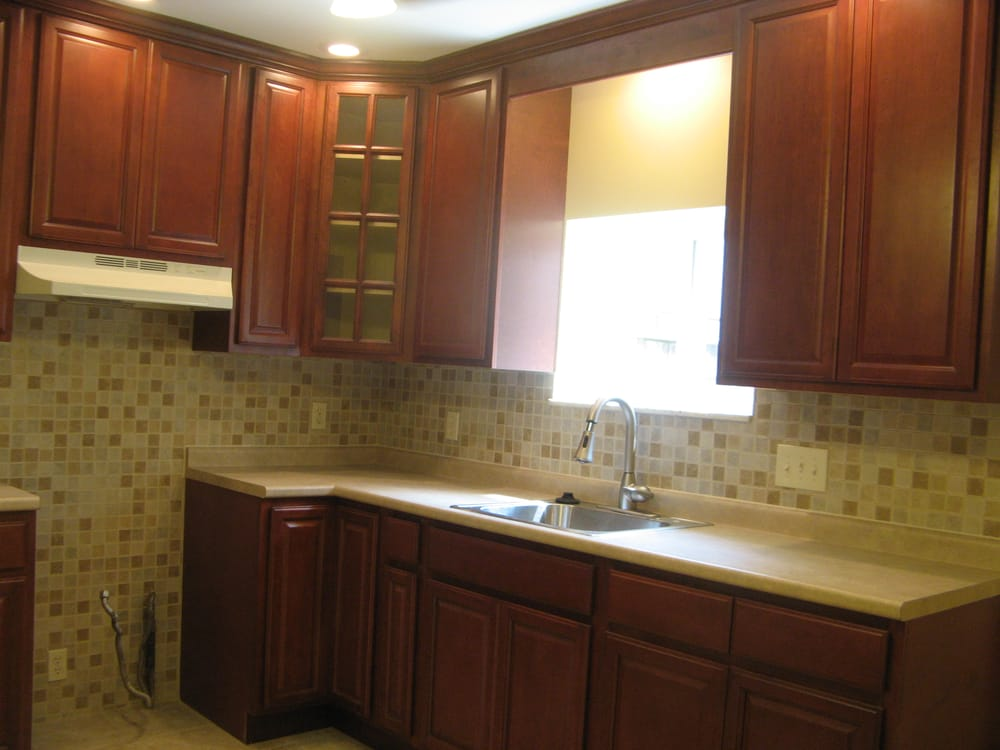 maple cabinets with a dark stain make this kitchen look ... on Dark Maple Cabinets  id=38248