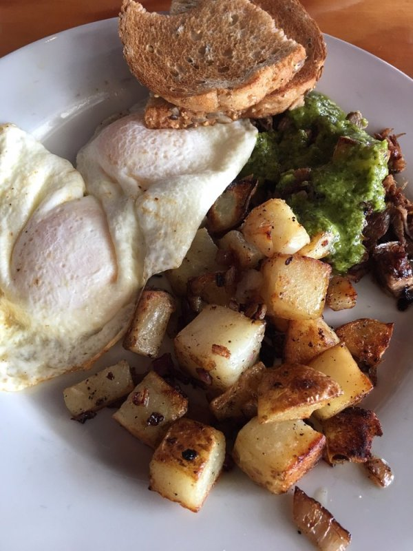 Steak and eggs! House braised steak was super tender and ...