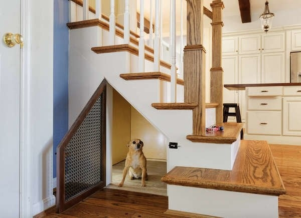 Under Stair Storage 17 Clever Ideas Bob Vila   Partition Of Stairs In Living Room   Lobby   Storage   Open Plan   Divider   Wood Paneling