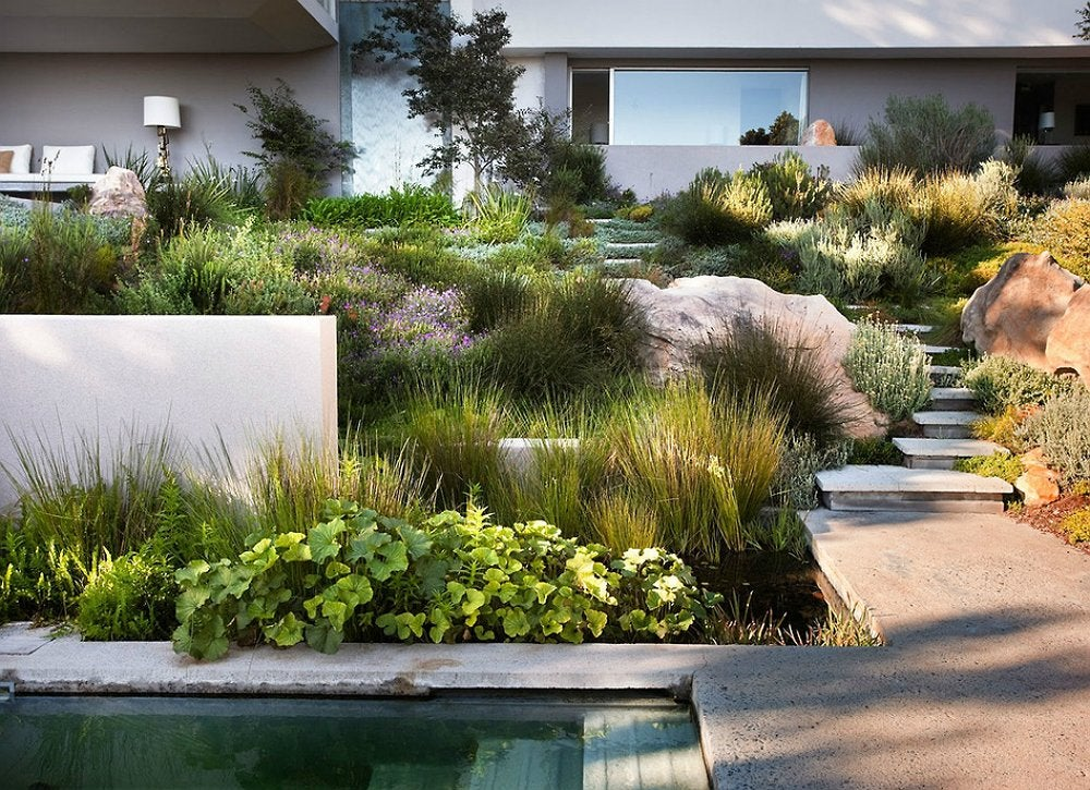 Small Backyard Ideas - 9 Ideas to Make Yours Feel Grand ... on Backyard Hill Landscaping Ideas id=65792