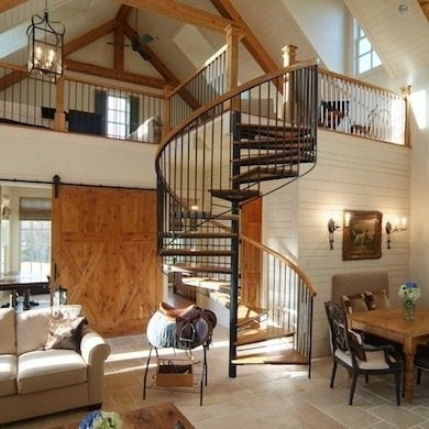 Spiral Stairs 11 Twisted Designs You Ll Love Bob Vila | Spiral Staircase Into Loft | Loft Conversion | Small Spaces | Tiny House | Space Saving | Staircase Design