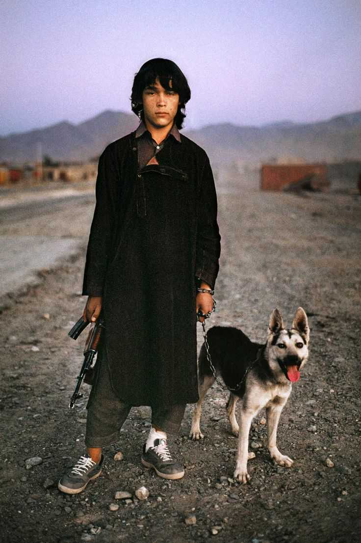 Afghan boy waits for a ride on the road to Kandahar, Afghanistan, 1992, final print_milan