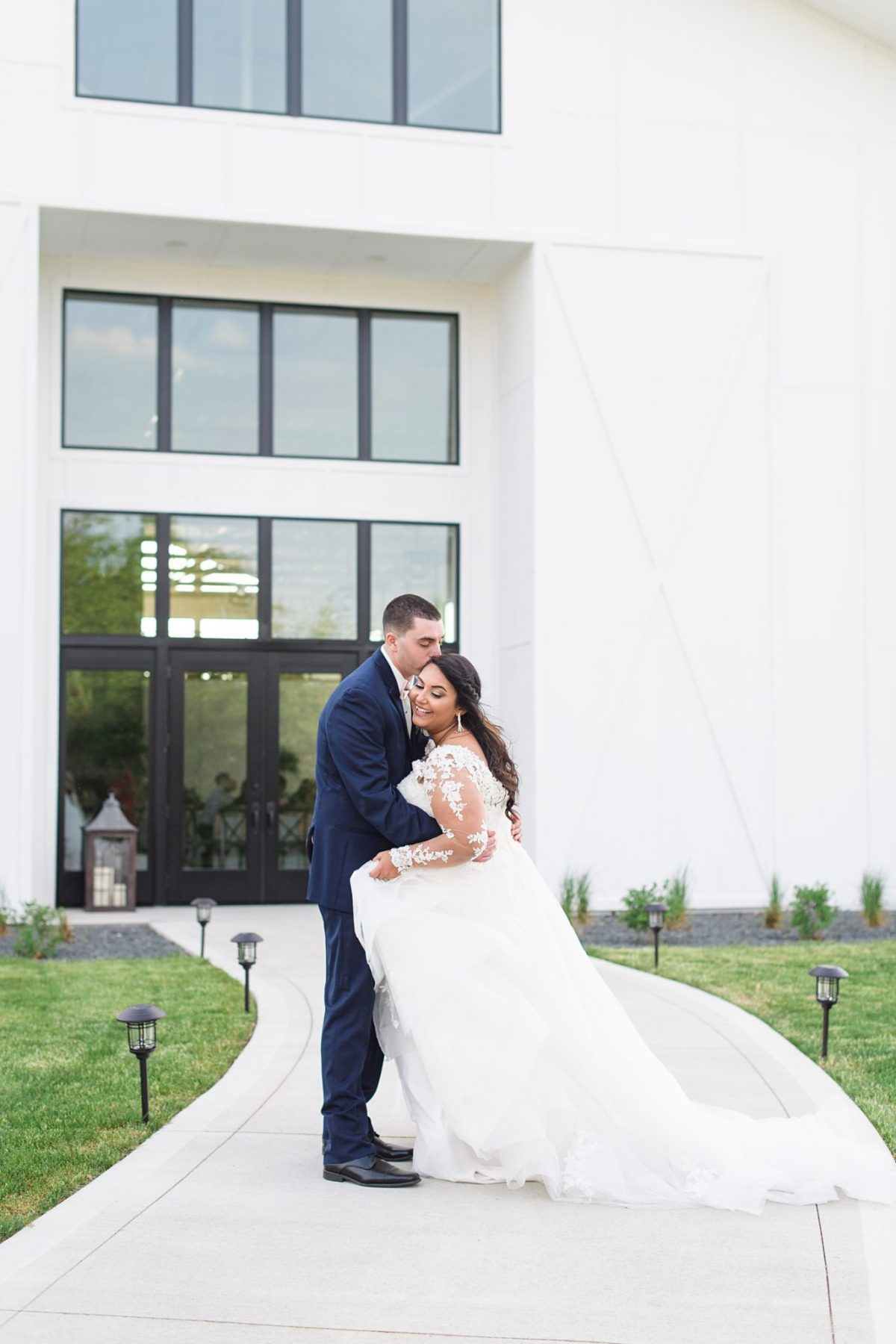 Bride and groom in front of Emerald Hills Event center