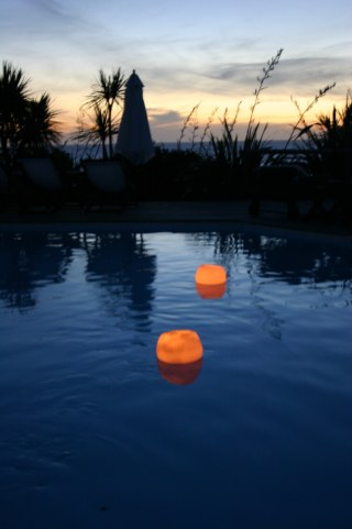 Posada del Faro pool candles at dusk