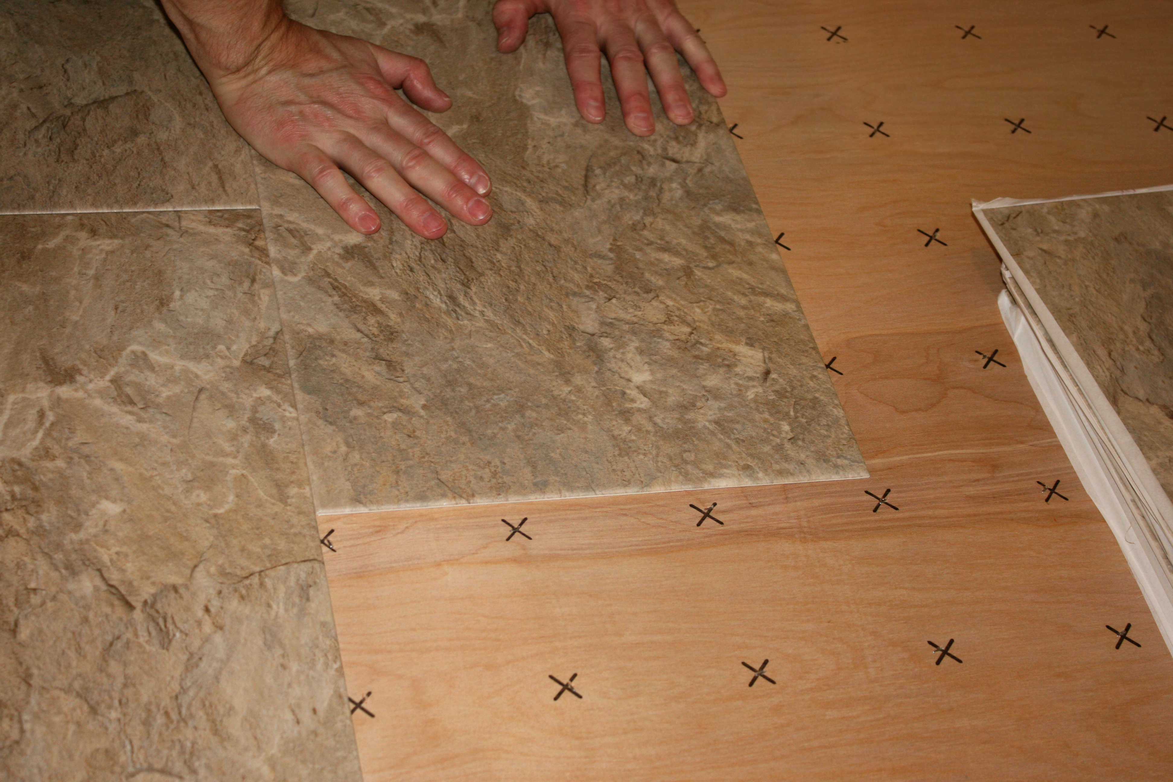 https homeguides sfgate com need remove linoleum before laying tile 66961 html
