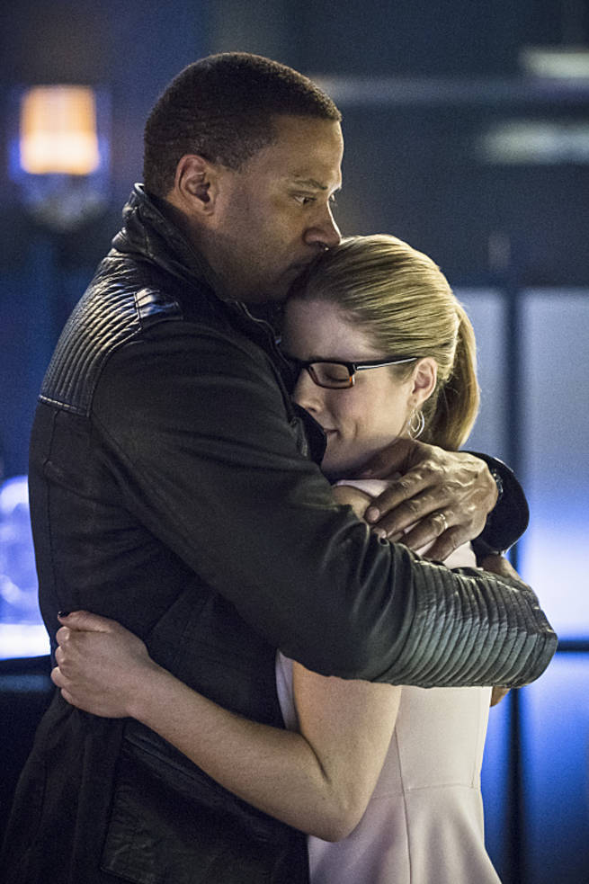 "Arrow -- ""Al Sah-Him"" -- Image AR321B_0342b -- Pictured (L-R): David Ramsey as John Diggle and Emily Bett Rickards as Felicity Smoak -- Photo: Cate Cameron/The CW -- © 2015 The CW Network, LLC. All Rights Reserved."