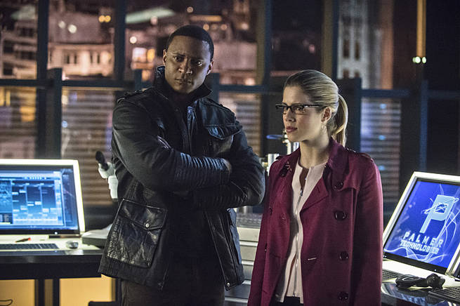 "Arrow -- ""Al Sah-Him"" -- Image AR321B_0243b -- Pictured (L-R): David Ramsey as John Diggle and Emily Bett Rickards as Felicity Smoak -- Photo: Cate Cameron/The CW -- © 2015 The CW Network, LLC. All Rights Reserved."