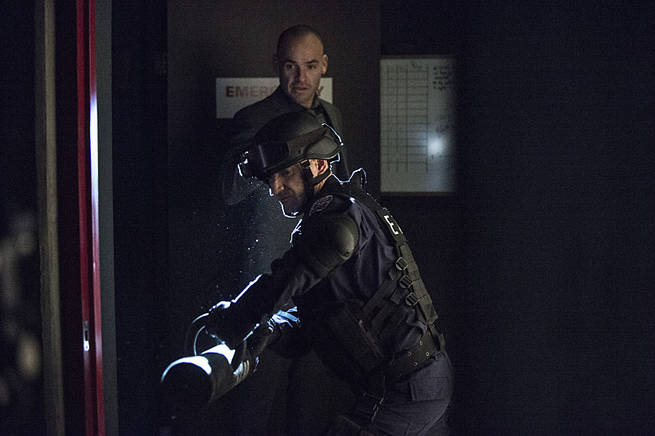 "Arrow -- ""Broken Arrow"" -- Image AR319B_0151b -- Pictured: Paul Blackthorne as Quentin Lance (back) -- Photo: Cate Cameron/The CW -- © 2015 The CW Network, LLC. All Rights Reserved."