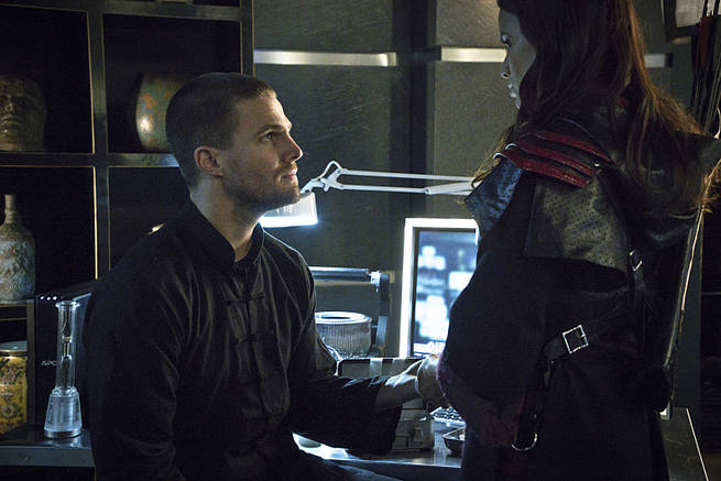 """Arrow -- """"My Name is Oliver Queen"""" -- Image AR323B_0269b -- Pictured (L-R): Stephen Amell as Oliver Queen and Katrina Law as Nyssa al Ghul -- Photo: Liane Hentscher/The CW -- © 2015 The CW Network, LLC. All Rights Reserved."""