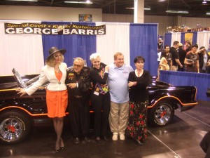 Julie Newmar, George Barris, Lee Meriwether, Burt Ward, and Yvonne Craig in front of the Batmobile