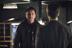"The Flash -- ""Legends of Today"" -- Image FLA208B_0199b.jpg -- Pictured (L-R): John Barrowman as Malcolm Merlyn and Grant Gustin as Barry Allen -- Photo: Cate Cameron/The CW -- © 2015 The CW Network, LLC. All rights reserved"