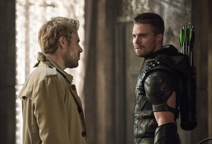 """Arrow -- """"Haunted"""" -- Image AR404B_0351b.jpg -- Pictured (L-R): Matt Ryan as Constantine and Stephen Amell as The Arrow -- Photo: Cate Cameron/ The CW -- © 2015 The CW Network, LLC. All Rights Reserved."""