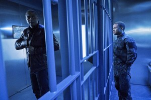 """Arrow -- """"A.W.O.L."""" -- Image AR411b_0237b.jpg -- Pictured (L-R): David Ramsey as John Diggle and Eugene Byrd as Andy Diggle -- Photo: Liane Hentscher/ The CW -- © 2016 The CW Network, LLC. All Rights Reserved."""