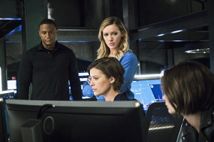 """Arrow -- """"A.W.O.L."""" -- Image AR411A_0259b.jpg -- Pictured (L-R): David Ramsey as John Diggle, Katie Cassidy as Laurel Lance, Audrey Marie Anderson as Lyla Michaels and Willa Holland as Thea Queen -- Photo: Liane Hentscher/ The CW -- © 2016 The CW Network, LLC. All Rights Reserved."""