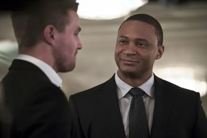 "Arrow -- ""Broken Hearts"" -- Image AR416a_0299b.jpg -- Pictured (L-R): Stephen Amell as Oliver Queen and David Ramsey as John Diggle -- Photo: Katie Yu/The CW -- © 2016 The CW Network, LLC. All Rights Reserved."