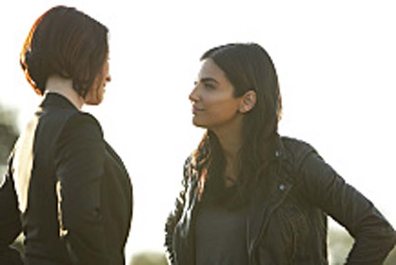 "Supergirl -- ""Welcome to Earth"" -- Image SPG203b_0160 -- Pictured (L-R): Chyler Leigh as Alex Danvers and Floriana Lima as Maggie Sawyer -- Photo: Bettina Strauss/The CW -- Ì?å© 2016 The CW Network, LLC. All Rights Reserved"