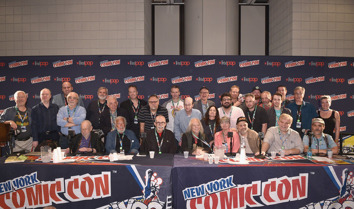 MAD Magazine Editor in Chief John Ficarra speak with Mad artists and writers Sam Viviano, Al Jaffee, Nick Meglin, Dick DeBartolo, Mark Fredrickson, Teresa Burns Parkhurst, Joe Raiola, and Charlie Kadau during the  Magazine Celebrates 65-Year Legacy With Legendary Creative Team Reunion at New York Comic Con on October 6, 2017 in New York City.  (Photo by Bryan Bedder/Getty Images for Mad Magazine)