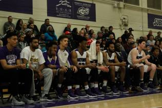 The San Francisco State University men's basketball team watch their teammates play against Chico State on Feb. 4, 2017 at the Swamp.