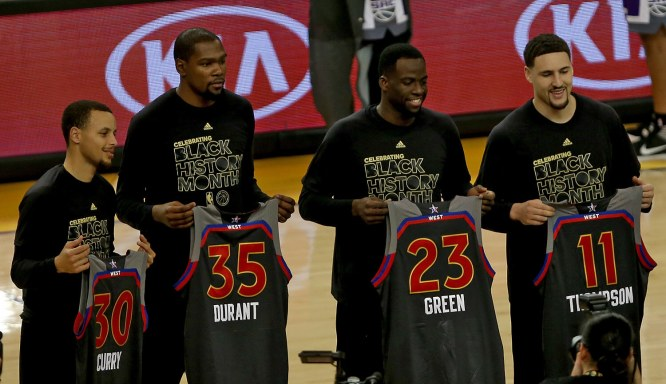 Golden State Warriors guard Stephen Curry (30), forward Kevin Durant (35), forward Draymond Green (23) and guard Klay Thompson (11) pose for a pregame portrait showing their All-Star jerseys as the Sacramento Kings face the Golden State Warriors at Oracle Arena in Oakland, Calif., on Wednesday, February 15, 2017.