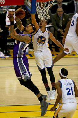 Golden State Warriors guard Stephen Curry (30) blocks the shot attempt by Sacramento Kings center Willie Cauley-Stein (00) in the first half as the Sacramento Kings face the Golden State Warriors at Oracle Arena in Oakland, Calif., on Wednesday, February 15, 2017.