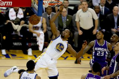 Warriors forward Kevin Durant dunks the ball in the second half of Golden State's 109-86 win over the Sacramento Kings in February at Oracle Arena.