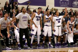 The SF State bench erupts in the fourth quarter on their way to a 93-67 win over CSU Los Angeles in the first round of the CCAA playoffs.