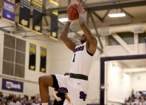 SF State Gators guard Warren Jackson (1) drives to the hoop with a dunk as the SF State Gators take on the Cal State LA Golden Eagles in a CCAA first round playoff game at SF State University in San Francisco, Calif., on Tuesday, February 28, 2017.