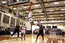 SF State Gators guard Israel Hakim (15) scores in the second half on an assist by guard Warren Jackson (1) as the SF State Gators take on the Cal State LA Golden Eagles in a CCAA first round playoff game at SF State University in San Francisco, Calif., on Tuesday, February 28, 2017.