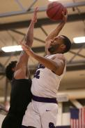 SF State Gators forward Derrick Brown (22) flies over Cal State LA forward Travis Hammonds (3) and scores as the SF State Gators take on the Cal State LA Golden Eagles in a CCAA first round playoff game at SF State University in San Francisco, Calif., on Tuesday, February 28, 2017.