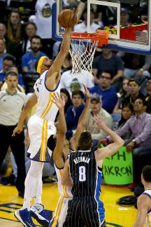 Golden State Warriors center Javale McGee (1) blocks the shot from Orlando Magic guard Mario Hezonja (8) in the first half as the Orlando Magic face the Golden State Warriors at Oracle Arena in Oakland, Calif., on Thursday, March 16, 2017.