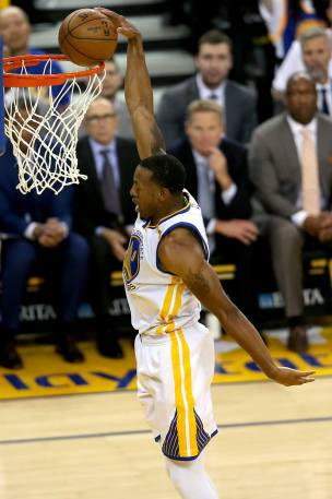 Golden State Warriors forward Andre Iguodala (9) slams it down in the first half as the Orlando Magic face the Golden State Warriors at Oracle Arena in Oakland, Calif., on Thursday, March 16, 2017.