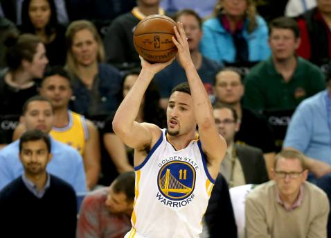 Warriors guard Klay Thompson drains a 3-pointer in the first half of Golden State's 122-92 win over the Orlando Magic Thursday night at Oracle Arena.