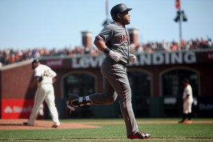 Arizona Diamondbacks left fielder Yasmany Tomas (24) rounds the bases after a home run in the fourth inning as the Arizona Diamondbacks face the San Francisco Giants on opening day at AT&T Park in San Francisco, Calif., on Monday, April 10, 2017.