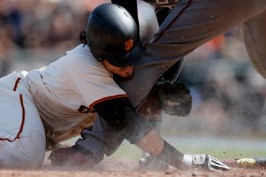 San Francisco Giants right fielder Jarrett Parker (6) scores in the fourth inning as the Arizona Diamondbacks face the San Francisco Giants on opening day at AT&T Park in San Francisco, Calif., on Monday, April 10, 2017.
