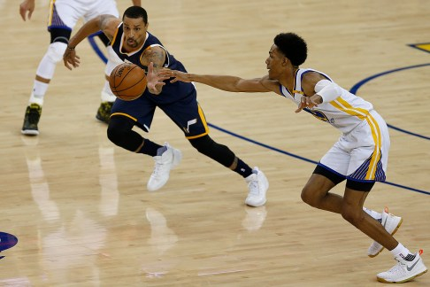 Utah Jazz guard George Hill (3) wins the loose ball from Golden State Warriors guard Patrick McCaw (0) in the first half as the Utah Jazz face the Golden State Warriors at Oracle Arena in Oakland, Calif., on Monday, April 10, 2017.