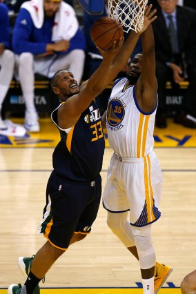 Golden State Warriors forward Kevin Durant (35) defends the hoop as Utah Jazz center Boris Diaw (33) tries to score as the Utah Jazz face the Golden State Warriors at Oracle Arena in Oakland, Calif., on Monday, April 10, 2017.
