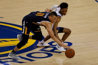 Utah Jazz guard Dante Exum (11) and Golden State Warriors guard Patrick McCaw (0) get after a loose ball in the second half as the Utah Jazz face the Golden State Warriors at Oracle Arena in Oakland, Calif., on Monday, April 10, 2017.