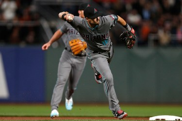 Arizona Diamondbacks shortstop Chris Owings (16) fields an infield hit by Eduardo Nunez in the second inning as the Arizona Diamondbacks face the San Francisco Giants at AT&T Park in San Francisco, Calif., on Tuesday April 11, 2017.